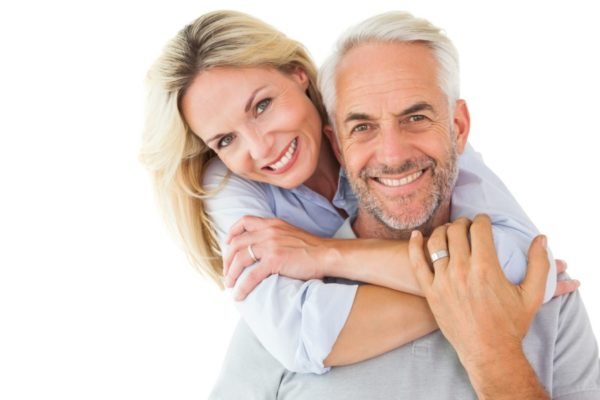 Happy healthy couple standing and hugging